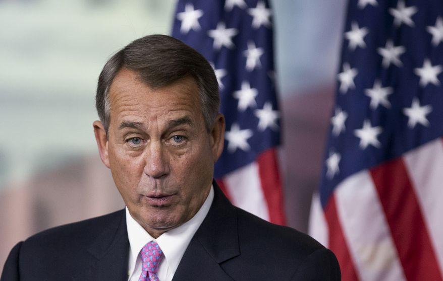 House Speaker John A. Boehner, Ohio Republican, speaks during a news conference on Capitol Hill in Washington on Thursday, Dec. 5, 2013. (AP Photo/Manuel Balce Ceneta)