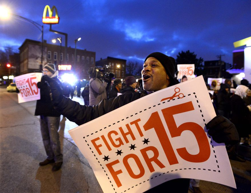 ** FILE ** Demonstrators rally for better wages outside a McDonald's restaurant in Chicago, Thursday, Dec. 5, 2013. Demonstrations planned in 100 cities are part of push by labor unions, worker advocacy groups and Democrats to raise the federal minimum wage of $7.25. (AP Photo/Paul Beaty)