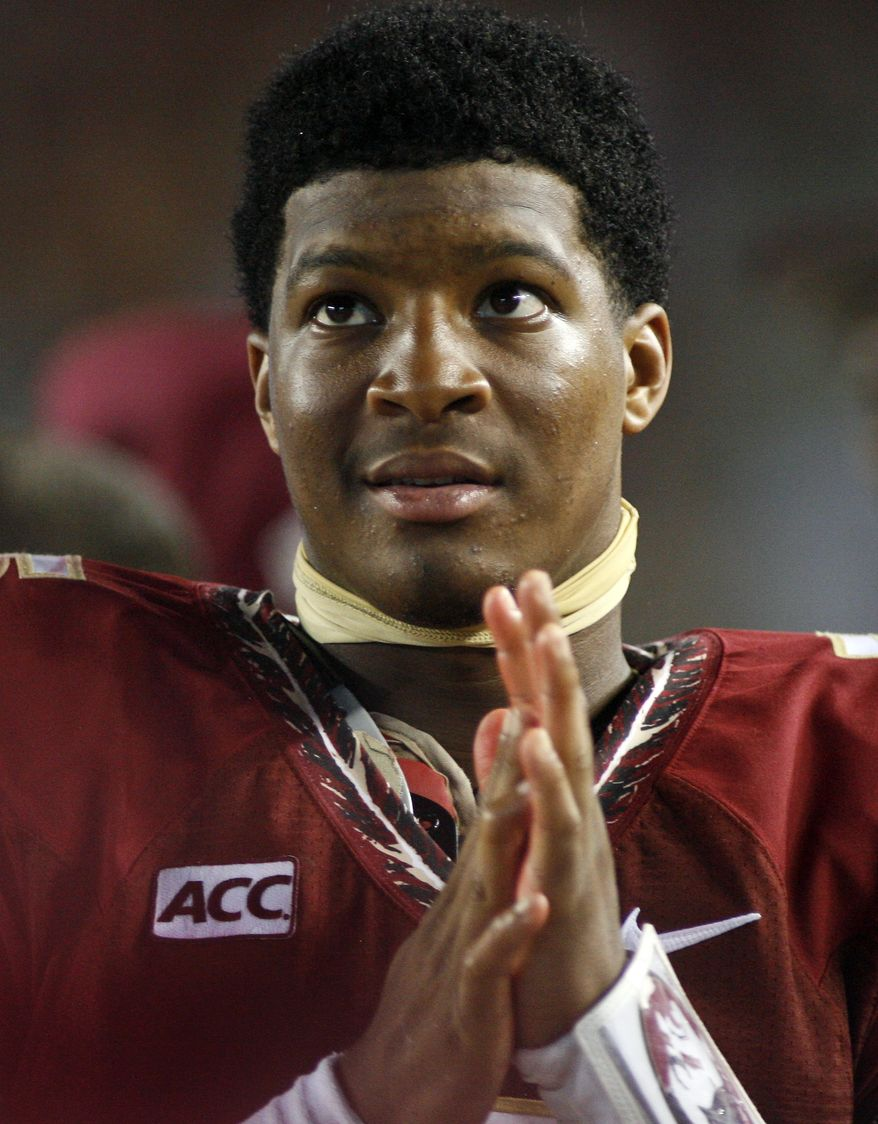 FILE - In this Sept. 21, 2013, file photo, Florida State quarterback Jameis Winston watches from the sidelines during the second half of an NCAA college football game against Bethune-Cookman in Tallahassee, Fla. Search warrants, released Thursday, dec. 5, 2013, in the sexual assault investigation of Winston indicate the woman told police she was raped at an apartment after a night of drinking at a bar. (AP Photo/Phil Sears, File)