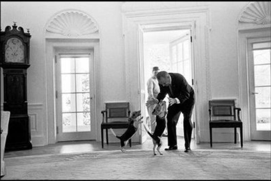 President Lyndon B. Johnson (1963-68) receives a greeting from his beagles, Him and Her. Johnson's beagles made the cover of Life magazine. January 19, 2009. (White House photo)