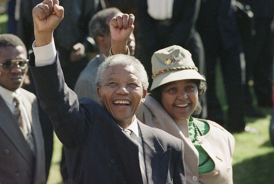 FILE - In this July 7, 1991, file photo, newly-elected African National Congress President Nelson Mandela and his wife, Winnie, greet the crowd after arriving at a rally and a week-long national ANC conference held inside South Africa for the first time in 30 years. South Africa's President Jacob Zuma said, Thursday, Dec. 5, 2013, that Mandela has died. He was 95. (AP Photo/John Parkin, File)