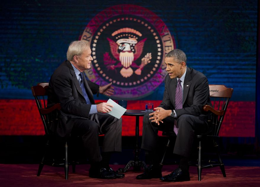 """President Barack Obama talks with MSNBC's Chris Matthews during a break in the taping of an interview for the """"Hardball with Chris Matthews"""" show, Thursday, Dec. 5, 2013, at American University in Washington. The show will are later Thursday. (AP Photo/ Evan Vucci)"""