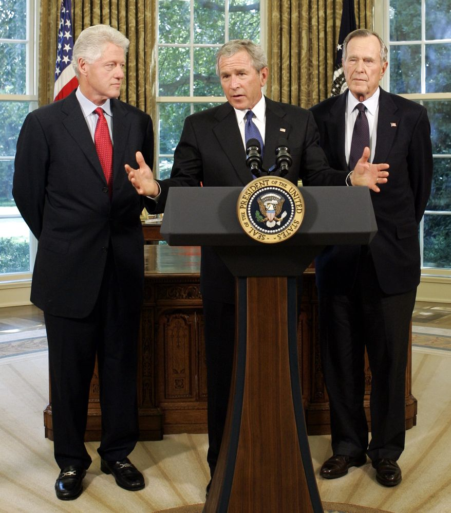 President Bush meets with former President George H.W. Bush, right, and former President Bill Clinton, left, in the Oval Office of the White House, Thursday, Sept. 1, 2005.  Bush, who will tour the hurricane-devastated Gulf Coast region on Friday, has asked his father, former President George H.W. Bush, and former President Bill Clinton to lead a private fund-raising campaign for victims as they did for last year's Asian tsunami. (AP Photo/Susan Walsh)