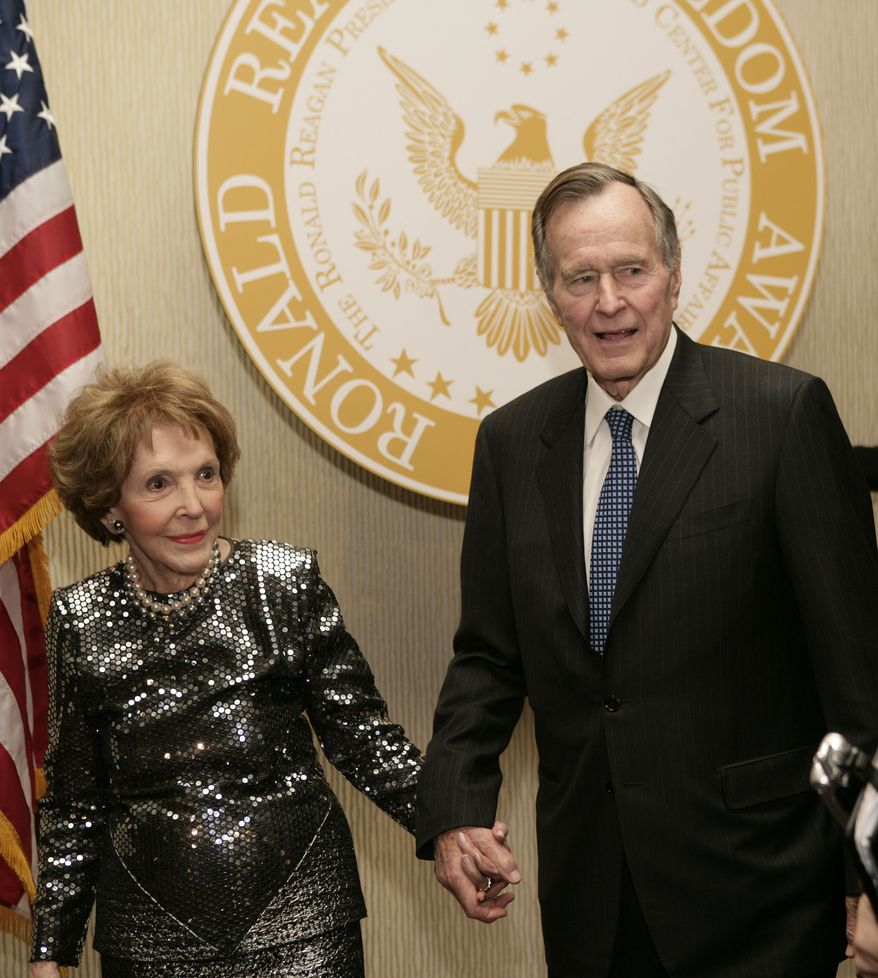 Former first lady Nancy Reagan and former President George H.W. Bush pose for photographs at the 2007 Ronald Reagan Freedom Award gala dinner honoring Bush, Tuesday, Feb. 6, 2007, in Beverly Hills, Calif. (AP Photo/Matt Sayles)