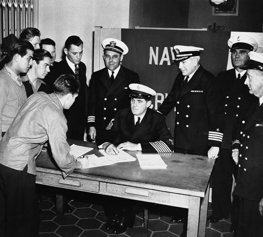 A crowd of young men enlist in the Navy in San Francisco, Calif., Dec. 7, 1941, at the Federal Office Building.  (AP Photo)