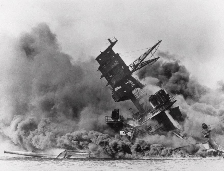 The battleship USS Arizona belches smoke as it topples over into the sea during a Japanese surprise attack on Pearl Harbor, Hawaii,  Dec. 7, 1941. The ship sank with more than 80  percent of its 1,500-man crew, including Rear Admiral Isaac C. Kidd . The attack, which left 2,343 Americans dead and 916 missing, broke the backbone of the U.S. Pacific Fleet and forced America out of a policy of isolationism. Congress declared war on Japan the morning after. According to AP-Kyodo polling 60 years after World War II ended, six in 10 Americans said they think another world war is likely, while only a third of the Japanese said another world war is likely. (AP Photo/File)