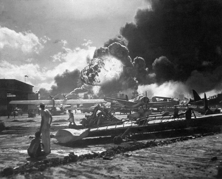 In this photo provided by the U.S. Navy, the wreckage strewn Naval Air Station at Pearl Harbor shown Dec. 7, 1941, after the Japanese sneak attacks. (AP Photo/U.S. Navy)