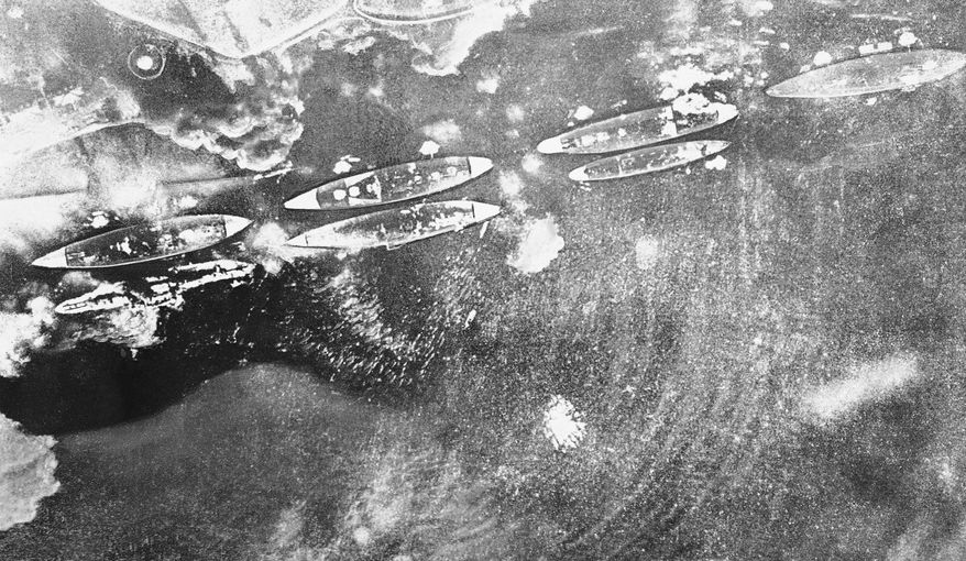 """This Japanese navy air view of smoking U.S. ships during Pearl Harbor attack appeared in a 1942  publication called """"The New Order in Greater East Asia,"""" a copy of which has just become available, Oct. 14, 1945 in New York. (AP Photo)"""