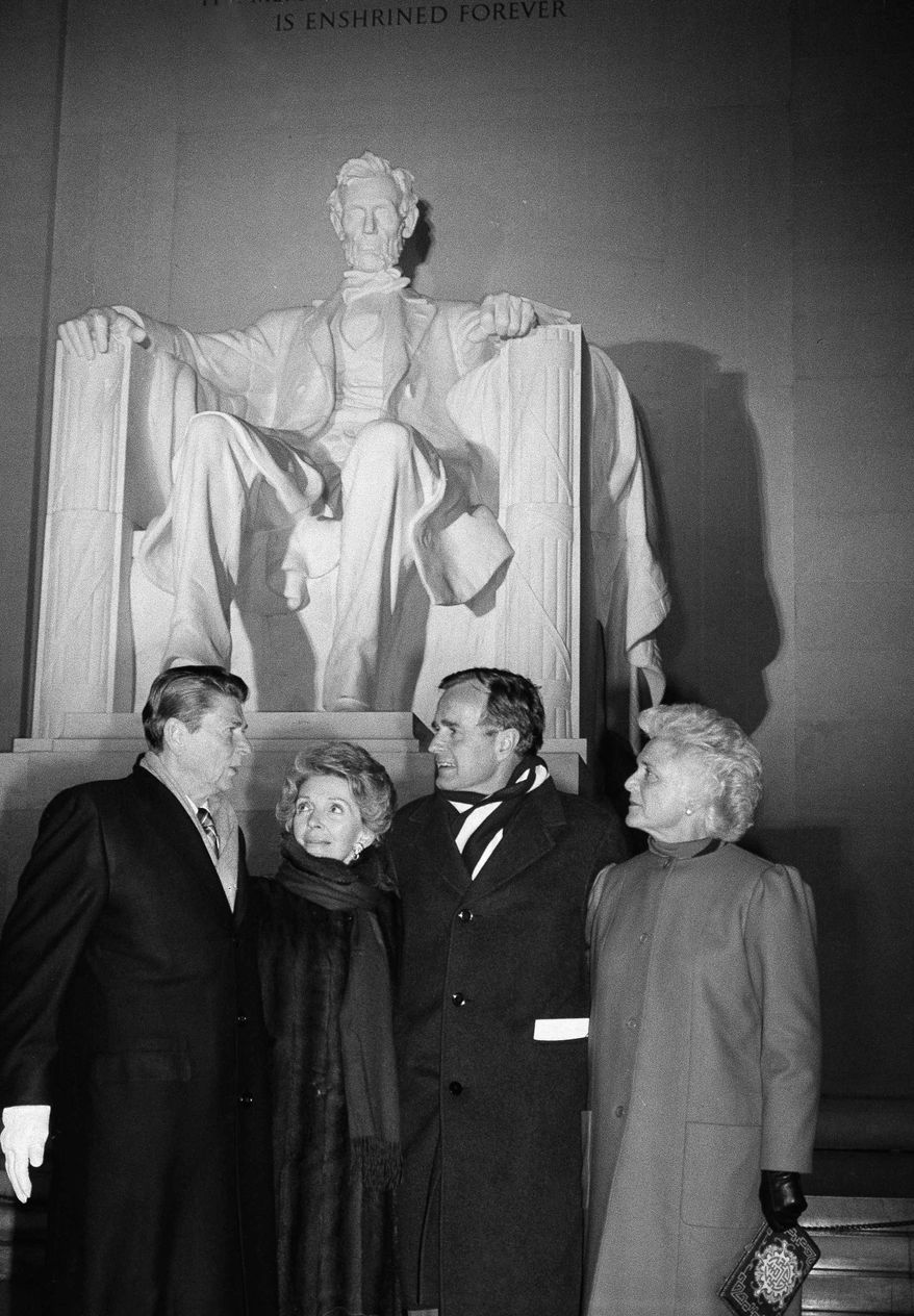 President-elect Ronald Reagan and his wife, Nancy, and Vice President-elect George Bush and his wife, Barbara, stand at the top of the steps of the Lincoln Memorial in Washington on Saturday, Jan. 17, 1981.   A ceremony officially beginning inaugural events was held at the Memorial. (AP Photo)