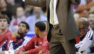 Washington Wizards head coach Randy Wittman gestures during the second half of an NBA basketball game against the Milwaukee Bucks, Friday, Dec. 6, 2013, in Washington. The Bucks won 109-105 in overtime. (AP Photo/Nick Wass)