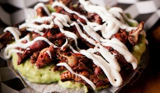 Toasted crickets on blue corn tostada. (Courtesy of Antojeria La Popular)