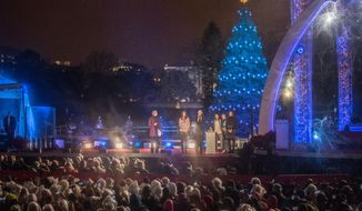 President Obama counts down the lighting of The National Christmas Tree as rain pours down, on the south lawn in front of the White House, in Washington, DC., Friday, December 6, 2013.  (Andrew S Geraci/The Washington Times)