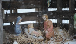 ** FILE ** Snow falls on a Nativity display at the home of Jerry and Linda Thompson near Paducah, Ky., on Friday, Dec. 6, 2013. (AP Photo/Stephen Lance Dennee)