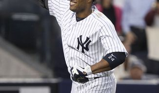 """FILE - In this June 6, 2012 file photo, New York Yankees' Robinson Cano smiles after hitting a solo home run during the fourth inning of a baseball game against the Tampa Bay Rays at Yankee Stadium in New York. The Seattle Mariners say that cannot confirm any details of a potential deal with free agent second baseman Robinson Cano. The team said Friday morning, Dec. 6, 2013, they will announce if an agreement is """"completed and finalized"""" with the Yankees star. The statement came in response to an ESPN report Friday morning that Cano and the Mariners had reached agreement on a $240 million, 10-year contract pending a physical.(AP Photo/Seth Wenig, File)"""