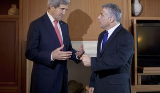 U.S. Secretary of State John Kerry, left, chats with Israeli Finance Minister Yair Lapid, right, before their meeting in Jerusalem, Israel, Friday, Dec. 6, 2013. (AP Photo/Pablo Martinez Monsivais, Pool)