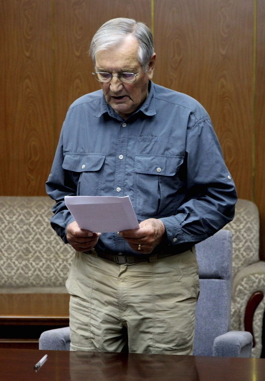 FILE - In this Nov. 9, 2013 file photo released by the Korean Central News Agency (KCNA) and distributed Nov. 30, 2013 by the Korea News Service, U.S. citizen Merrill Newman, 85, reads a document, which North Korean authorities say was an apology that Newman wrote and read in North Korea. North Korea said Saturday Dec. 7, 2013, that it has deported the elderly U.S. tourist and war veteran detained for more than a month for alleged hostile acts against the country.  (AP Photo/KCNA via KNS)