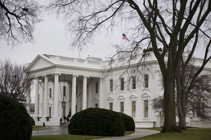 The flag above the White House flies at half-staff in honor of the late South African President Nelson Mandela on Friday, Dec. 6, 2013, in Washington. (AP Photo/Evan Vucci)