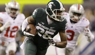 Michigan State's Keith Mumphery (25) makes a 72-yard touchdown reception during the first half of a Big Ten Conference championship NCAA college football game against Ohio State, Saturday, Dec. 7, 2013, in Indianapolis. (AP Photo/Michael Conroy)