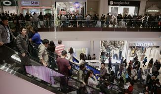 Bargain-hunting motorists willing to drive to another state can save up to 10 percent on Black Friday shopping.(AP Photo/Jae C. Hong, File)