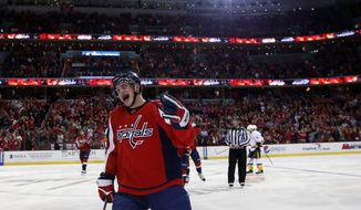 Washington Capitals defenseman Nate Schmidt (88) celebrates his first goal of the season, in the third period of an NHL hockey game against the Nashville Predators, Saturday, Dec. 7, 2013, in Washington. The Capitals won 5-2. (AP Photo/Alex Brandon)