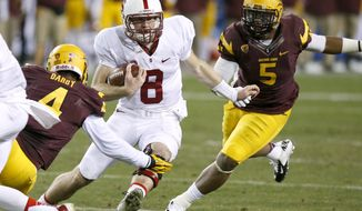 Stanford's Kevin Hogan (8) runs with the ball as Arizona State's Alden Darby (4) and Chris Young (5) move in to defend during the first half of the NCAA Pac-12 Championship football game Saturday, Dec. 7, 2013, in Tempe, Ariz. (AP Photo/Ross D. Franklin)
