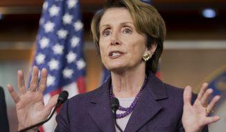 House Minority Leader Nancy Pelosi, California Democrat, speaks at a news conference on Capitol Hill in Washington on Thursday, Dec. 5, 2013. (AP Photo/J. Scott Applewhite)
