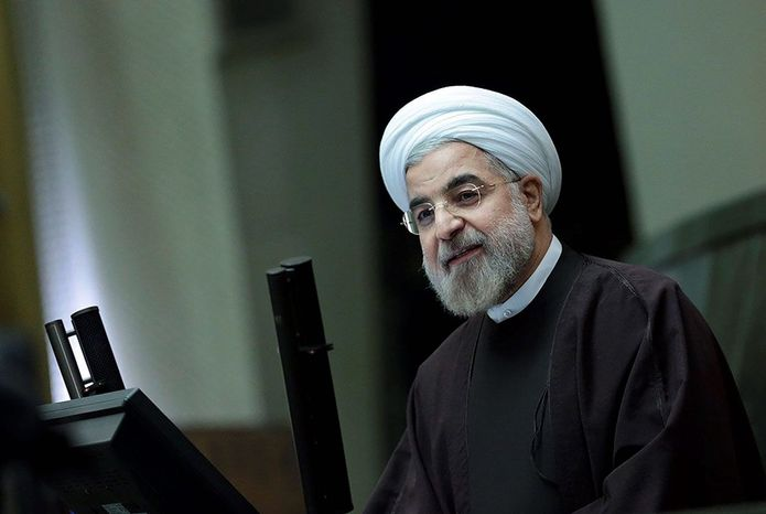 """Iranian President Hassan Rouhani says Sunday that the nuclear deal with world powers already has boosted the country's economy. """"They're ready to buy; they have the money now,"""" said E.J. Miller, founder of the Iran America Chamber of Commerce. (Office of the president of Iran via Associated Press)"""
