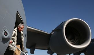 Secretary of Defense Chuck Hagel steps off a plane to visit U.S. troops in Kandahar, Afghanistan, on Sunday, Dec. 8, 2013. Mr. Hagel spoke with troops and thanked them for being deployed during the holidays. (AP Photo/Mark Wilson, Pool)