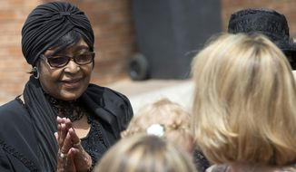Winnie Madikizela-Mandela (left), anti-apartheid icon and Nelson Mandela's ex-wife, greets worshippers at the Bryanston Methodist Church in the Bryanston suburb of Johannesburg on Sunday, Dec. 8, 2013, as South Africa observed a day of prayer for Mr. Mandela, who died Thursday. (AP Photo/Peter Dejong) ** FILE **