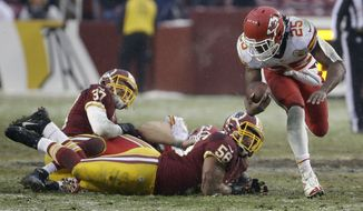Kansas City Chiefs running back Jamaal Charles leaves Washington Redskins strong safety Reed Doughty (37) and inside linebacker Perry Riley on the ground as he carries the ball for long yardage during the second half of an NFL football game in Landover, Md., Sunday, Dec. 8, 2013. (AP Photo/Pablo Martinez Monsivais)