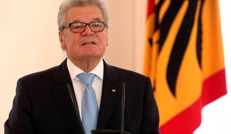 German President Joachim Gauck speaks at the Bellevue Palace, his official residence, in Berlin on Monday, Dec. 2, 2013. (AP Photo/dpa, Wolfgang Krumm)