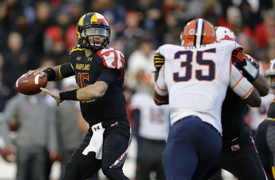FILE - In this Nov. 9, 2013 file photo, Maryland quarterback C.J. Brown, left, throws to a receiver as he is pressured by Syracuse linebacker Dyshawn Davis during an NCAA college football game in College Park, Md. Maryland won't have to cross the state line for its first bowl appearance since 2010. The Terrapins will face Marshall in the Military Bowl on Dec. 27. The game will be held at the home stadium of the Naval Academy, which is around 28 miles from the Maryland campus. (AP Photo/Patrick Semansky, File)