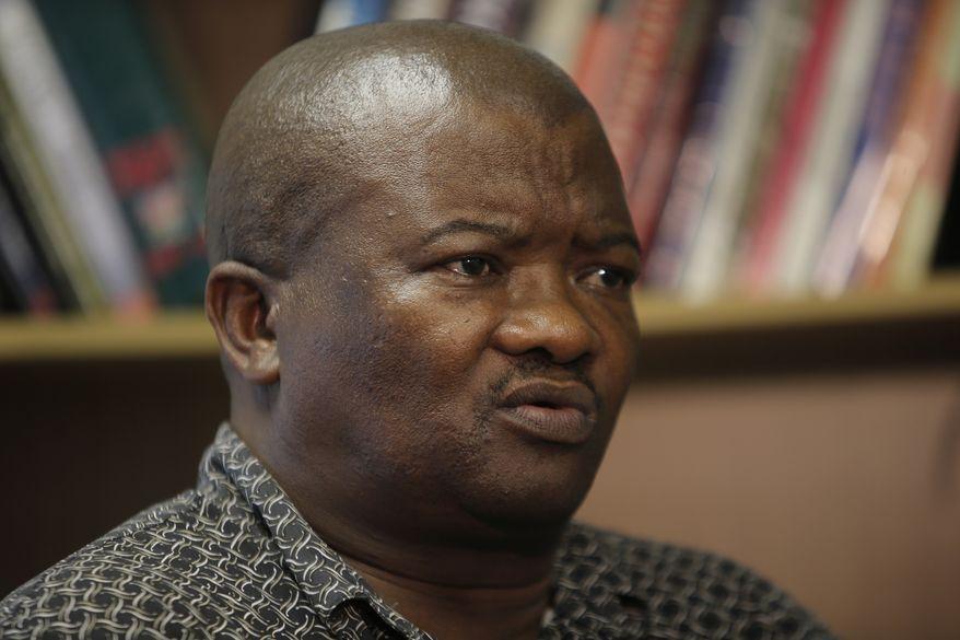 Veteran South African politician Bantu Holomisa speaks to The Associated Press about Nelson Mandela's last hours as Mr. Holomisa is interviewed in Johannesburg on Sunday, Dec. 8, 2013. (AP Photo/Tsvangirayi Mukwazhi)