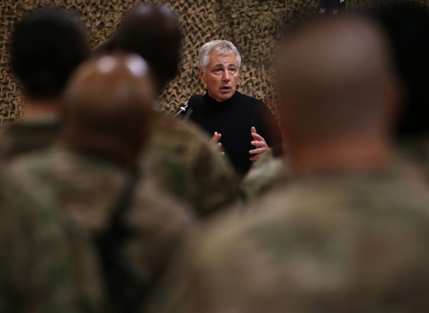 U.S. Secretary of Defense Chuck Hagel, speaks with U.S. troops at the Kandahar air base in Afghanistan, Sunday, Dec. 8, 2013. Hagel spoke with U.S. troops and thanked them for being deployed for the holidays. (AP Photo/Mark Wilson, Pool)