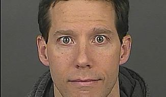 """This photo provided by Denver Police shows Aron Ralston, 38.  Ralston, who cut off his forearm to free himself after becoming trapped by a dislodged boulder in a Utah canyon, has been arrested in Denver for domestic violence. He was booked into the Downtown Detention Center on Sunday, Dec. 8, 2013 on charges of assault and wrongs to minors. Ralston was hiking in 2003 when he became trapped by a boulder and was forced to cut off his own arm to free himself. He went on to detail his struggles in a book, and his story was later adapted into the movie """"127 Hours.""""  (AP Photo/Denver Police)"""