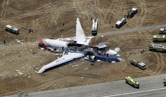 ** FILE ** In this Saturday, July 6, 2013, aerial photo, the wreckage of the Asiana Flight 214 airplane is seen after it crashed at the San Francisco International Airport in San Francisco, Saturday, July 6, 2013. (AP Photo/Marcio Jose Sanchez)