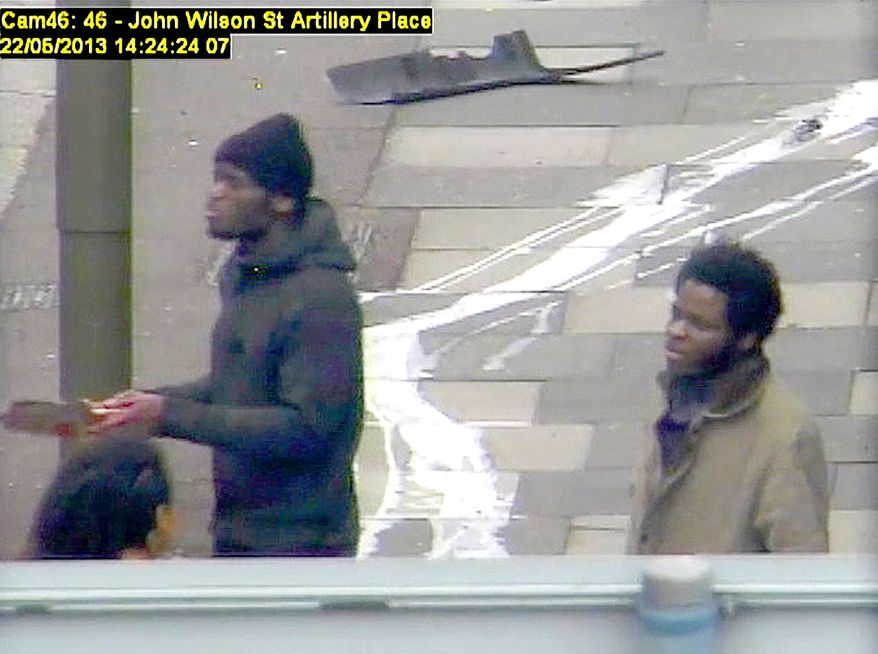 ** FILE ** Michael Adebolajo and Michael Adebowale speak to a member of the public near the Woolwich Barracks in London in May 2013 in this photo made from CCTV and released by the Metropolitan Police on Tuesday, Dec. 3, 2013. (AP Photo/Metropolitan Police)