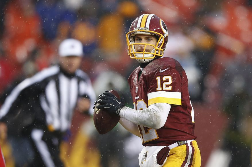 Washington Redskins quarterback Kirk Cousins looks for an opening to pass during the second half of an NFL football game against Kansas City Chiefs in Landover, Md., Sunday, Dec. 8, 2013. The Chiefs defeated the Redskins 45-10. (AP Photo/Evan Vucci)