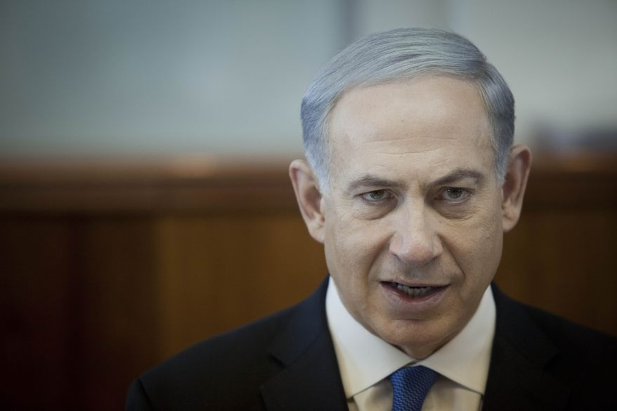 ** FILE ** In this file photo taken Sunday, Nov. 17, 2013, Israel's Prime Minister Benjamin Netanyahu attends a weekly cabinet meeting in Jerusalem. (AP Photo/Dan Balilty, File, Pool)