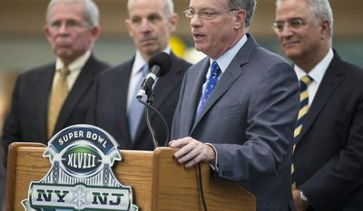 """Alfred F. Kelly Jr., president and CEO of the NY/NJ Super Bowl Host Co., speaks alongside (from left to right) Jim Weinstein, executive director of NJ Transit; Jonathan Tisch, co-chairman of the Super Bowl Host Co.; and Carmen Bianco, president of MTA New York City Transit, during a news briefing at the Frank R. Lautenberg Secaucus Junction Station in Secaucus, N.J., on Monday, Dec. 9, 2013. Organizers are calling Super Bowl XLVIII at New Jersey's MetLife Stadium on Feb. 2 the first """"public transportation"""" Super Bowl. (AP Photo/John Minchillo)"""
