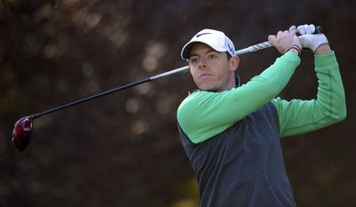Rory McIlroy, of Northern Ireland, tees off on the second hole during the first round of the Northwestern Mutual World Challenge golf tournament at Sherwood Country Club, Thursday, Dec. 5, 2013, in Thousand Oaks, Calif. (AP Photo/Mark J. Terrill)