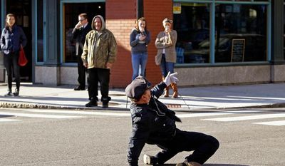 "** FILE ** Reserve Officer Tony Lepore, the ""dancing cop,"" directs traffic on Dorrance Street in downtown Providence, R.I., on Thursday, Dec. 13, 2012. (AP Photo/Stephan Savoia)"