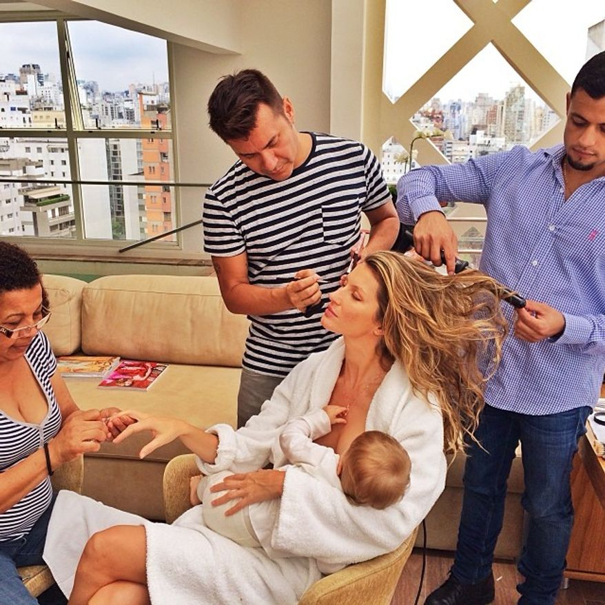 Supermodel Gisele Bundchen posted a photo on Instagram of her breastfeeding her one-year-old daughter while being primped by her beauty team.