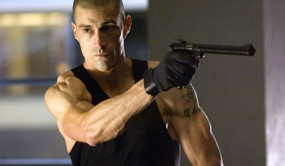 Matthew Fox as Alex Cross with his Ruger MKII .22LR handgun.