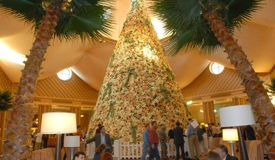 **FILE** Attendees of the Major League Baseball winter meetings and trade show congregate in the lobby of the Dolphin Hotel in Lake Buena Vista, Fla., Tuesday, Dec. 5, 2006. (AP Photo/Phelan M. Ebenhack)