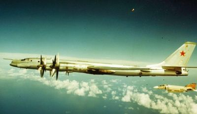 U.S. Navy F-4 Phantom fighter jets and Soviet Tu-95 Bear have a close encounter during the Cold War. (Image: U.S. Navy)