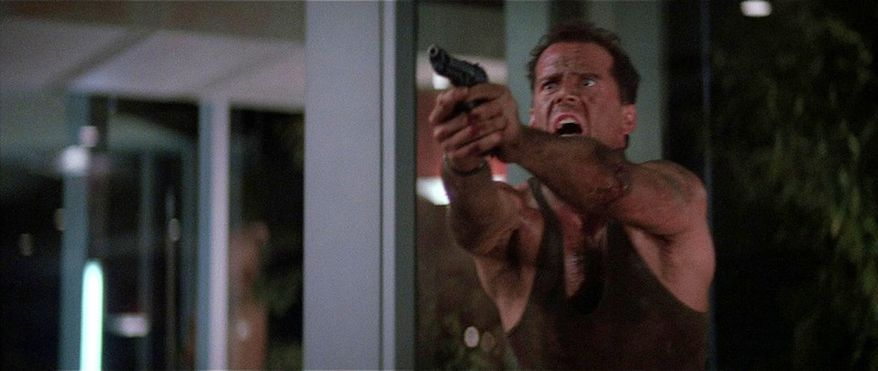 Bruce Willis stars as John McLane in Die Hard with a Beretta 92F handgun.
