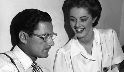 "Oscar-nominated actress Eleanor Parker, here with Errol Flynn on the set of ""Never Say Goodbye,"" died on Monday, Dec. 9, 2013, at age 91. She played the scheming baroness in the film version of Rodgers and Hammerstein's ""The Sound of Music."" (AP Photo)"