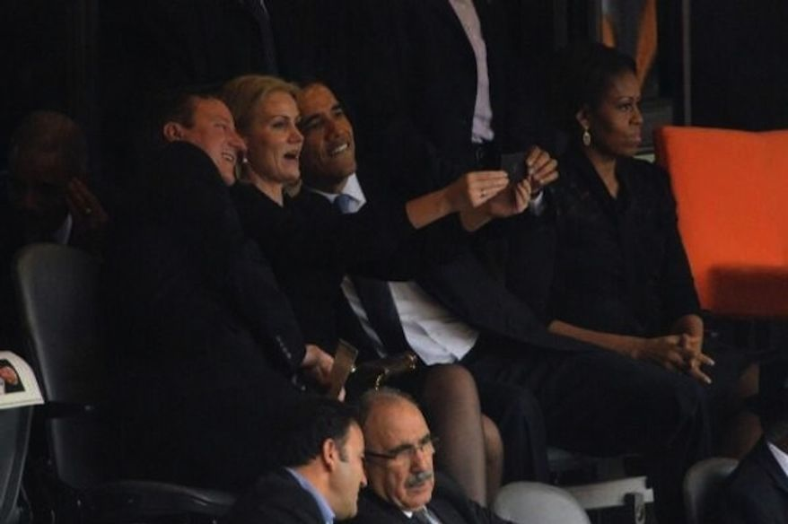 """A photo posted on the New York Post's Twitter account shows President Obama posing for a """"selfie"""" photo with Britain Prime Minister David Cameron and Danish Prime Minister Helle Thorning-Schmidt."""