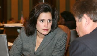 Michigan state Sen. Gretchen Whitmer, the state Senate's Democratic minority leader, cited her own rape in criticizing the Republican-controlled Legislature's final approval on Wednesday, Dec. 11, 2013, of a bill that bans commercial insurance policies from covering abortions unless a woman buys a separate rider to include abortion services. (AP Photo/Michigan Legislature)